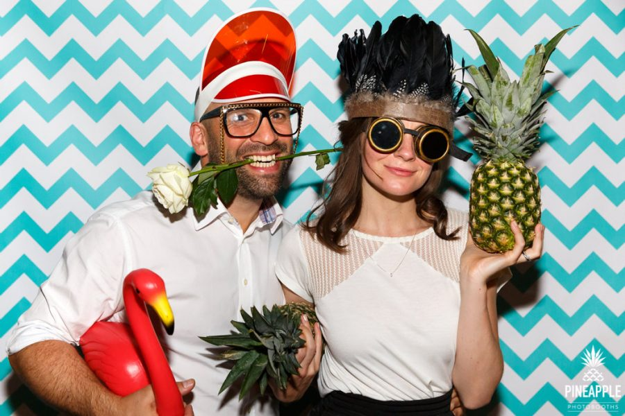 Manchester photo booth hire with flamingo and feather headdress props